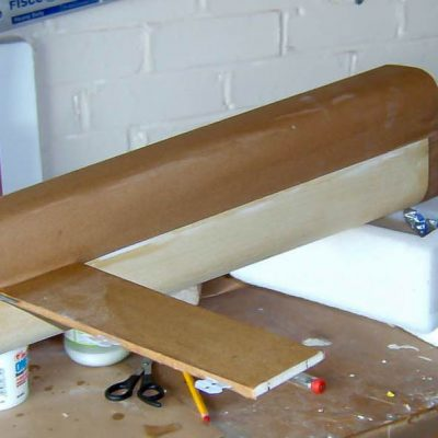 Fuselage partly covered in brown paper